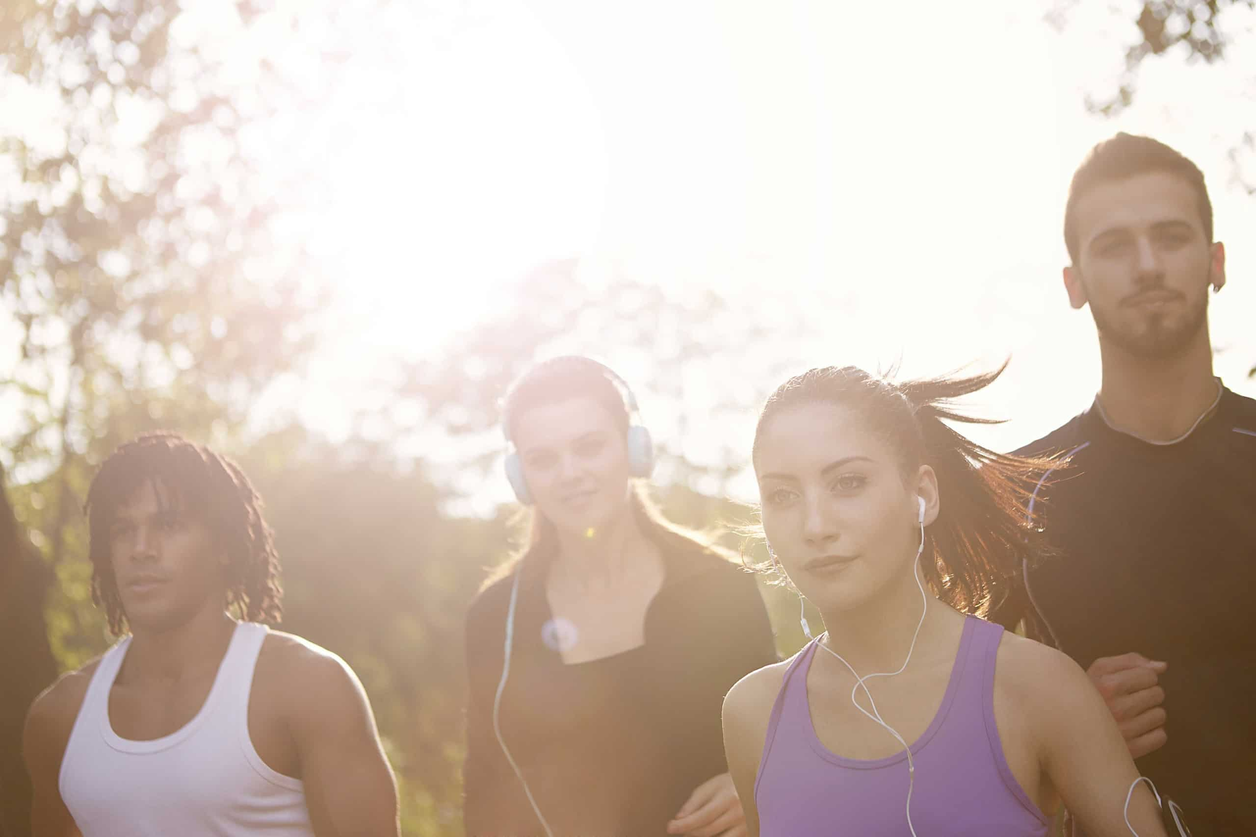 Group of people running in the summer