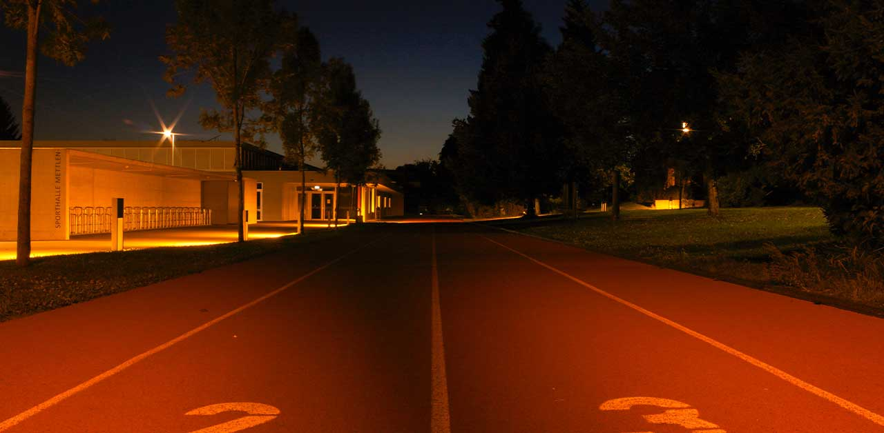 Running on a track at night.