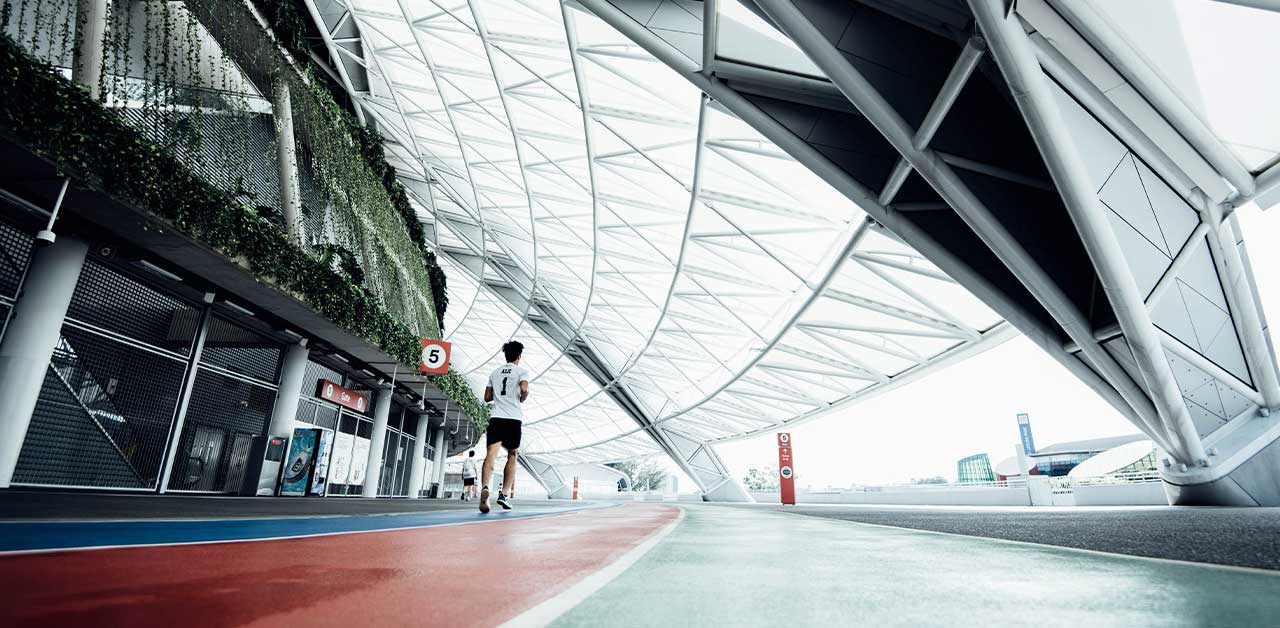Person running on an indoor running track