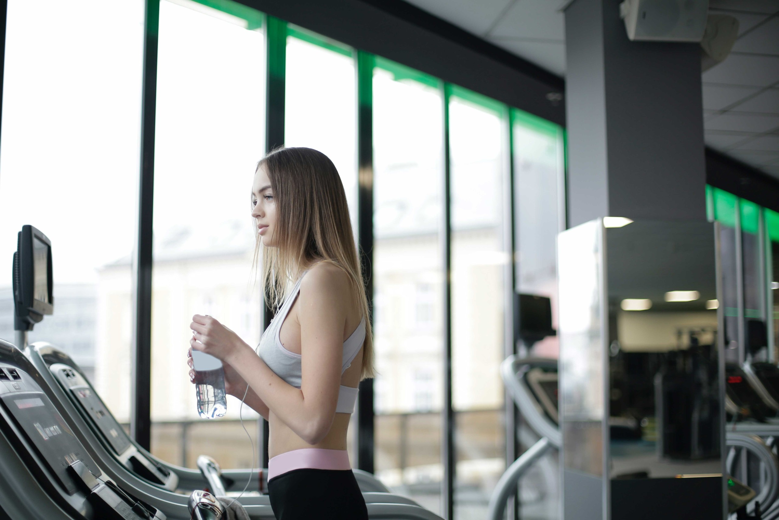 Woman standing on a treadmill