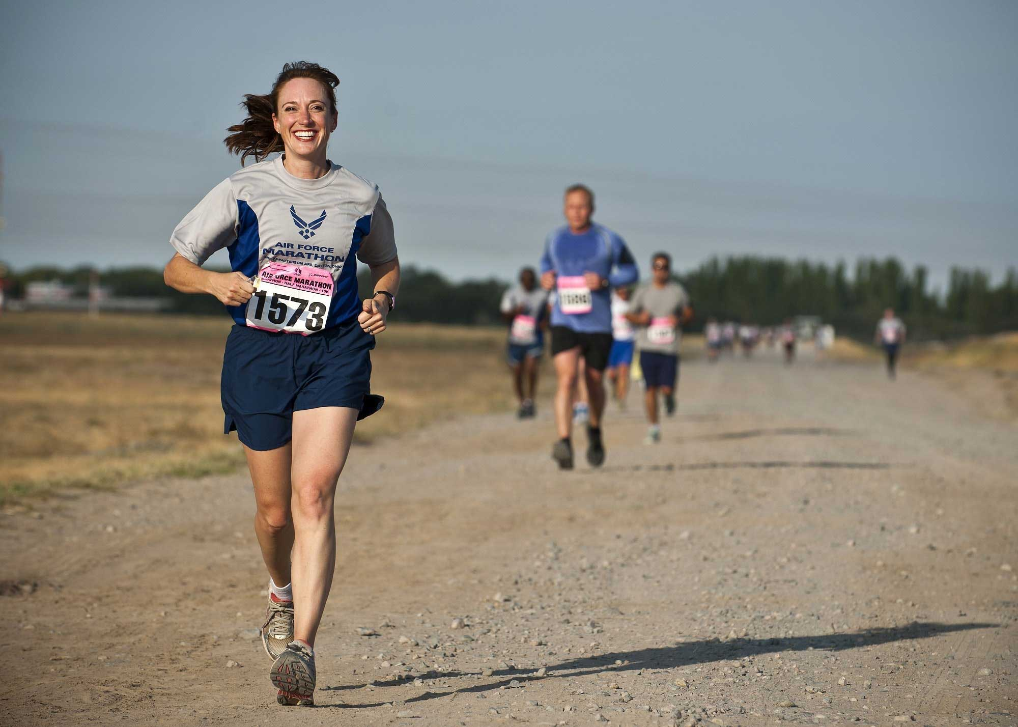 Athletes running together on a dirt road