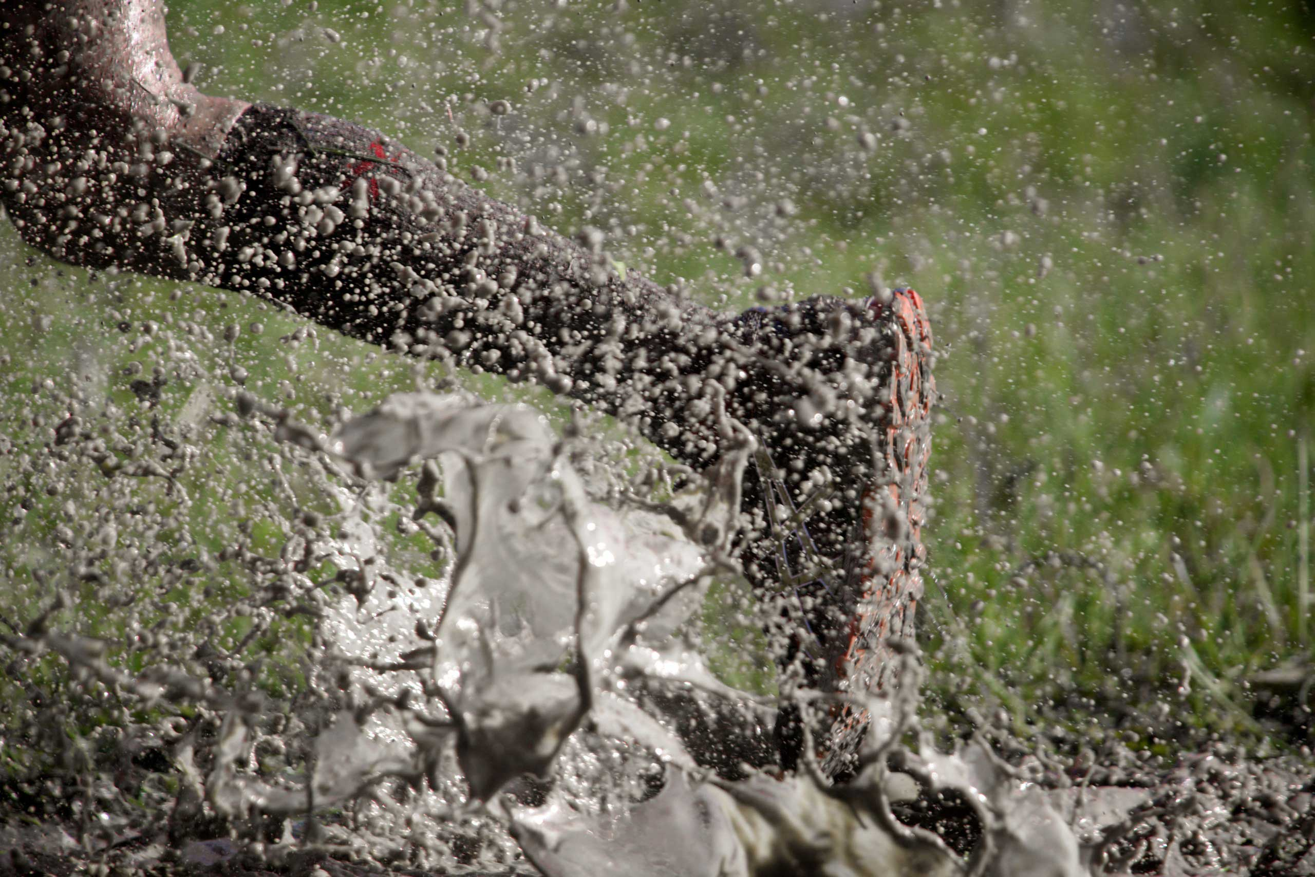 Person running through mud