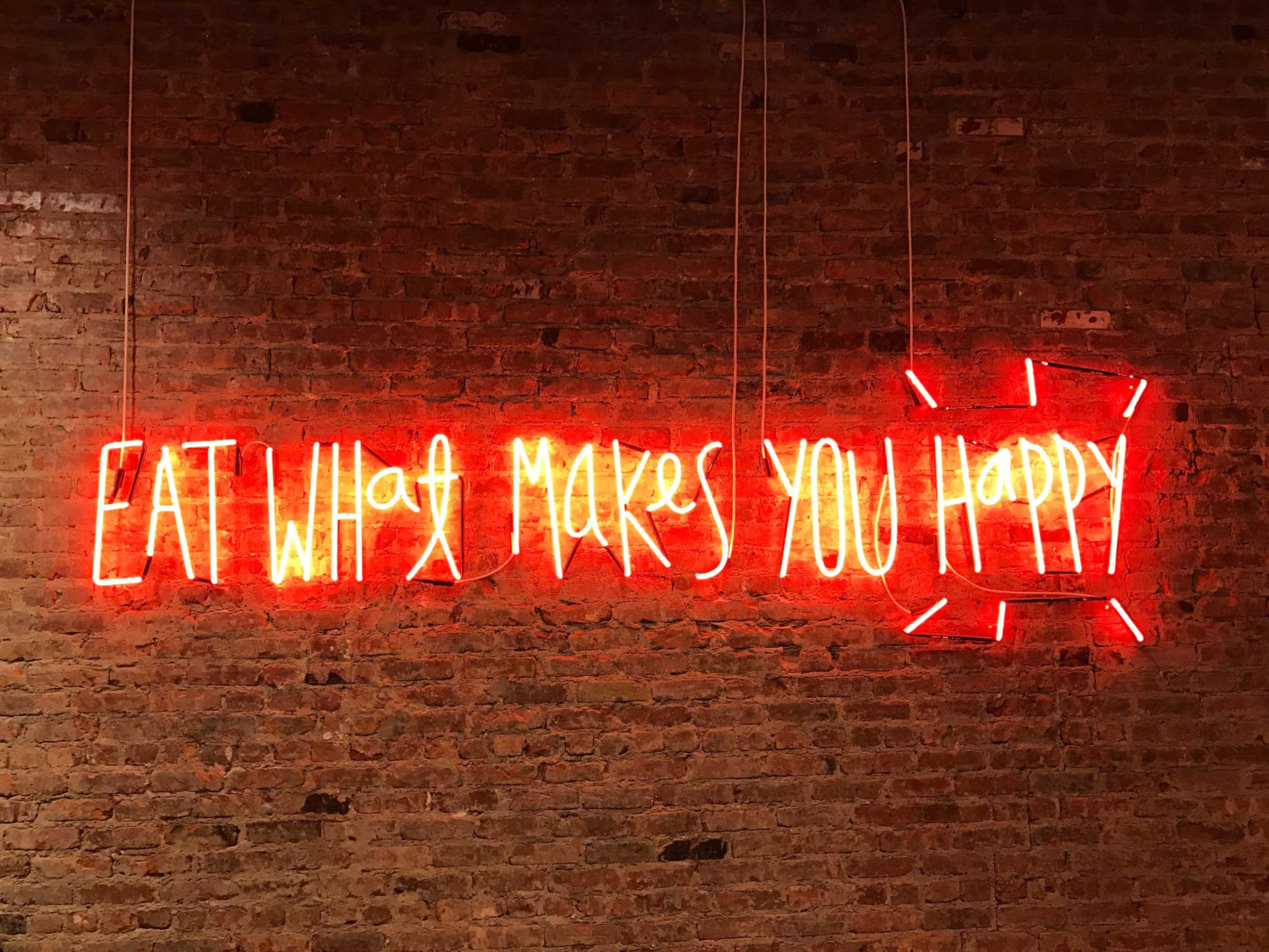 Eat what makes you happy motivational sign