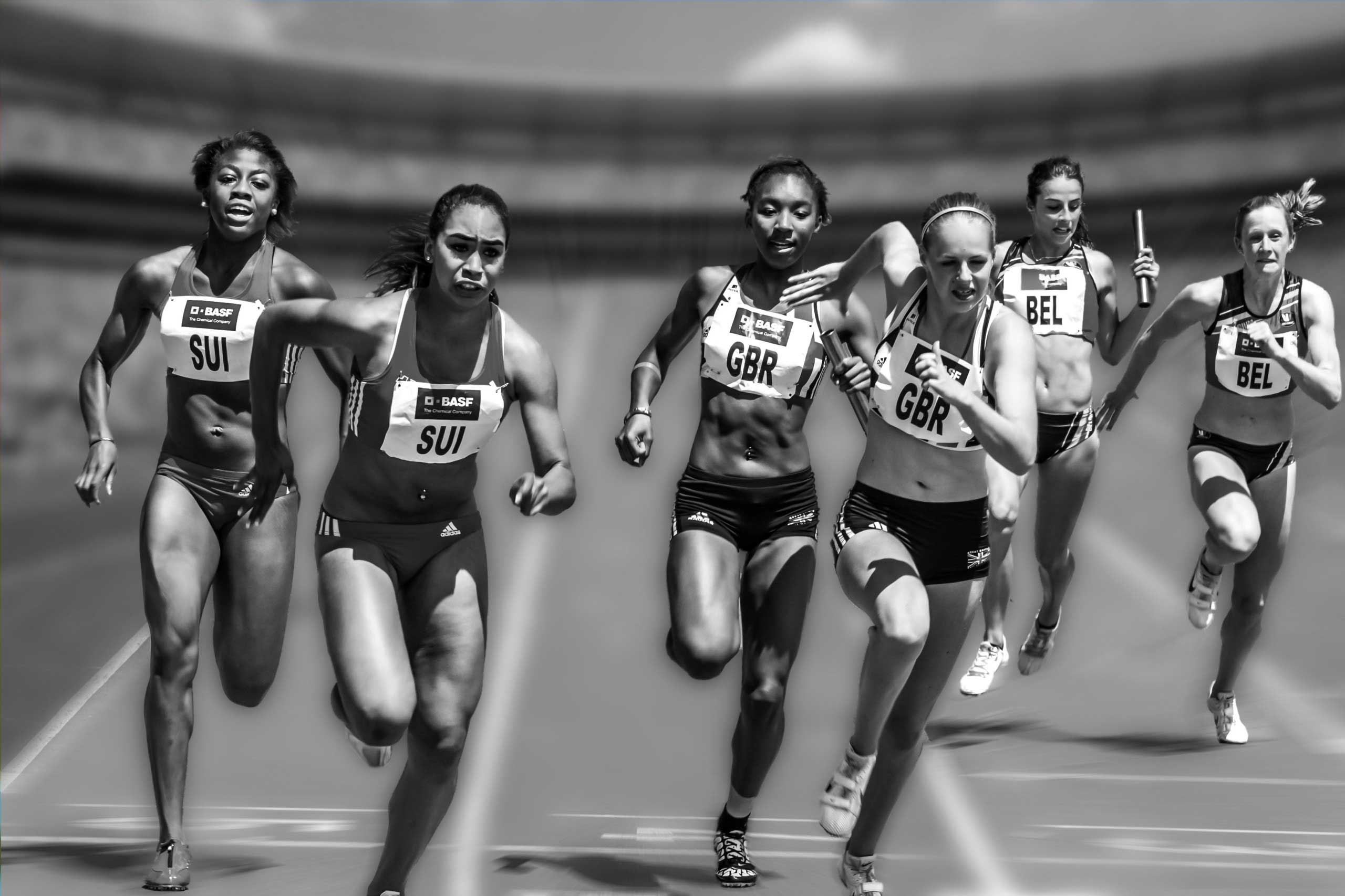 Group of women running on a race track