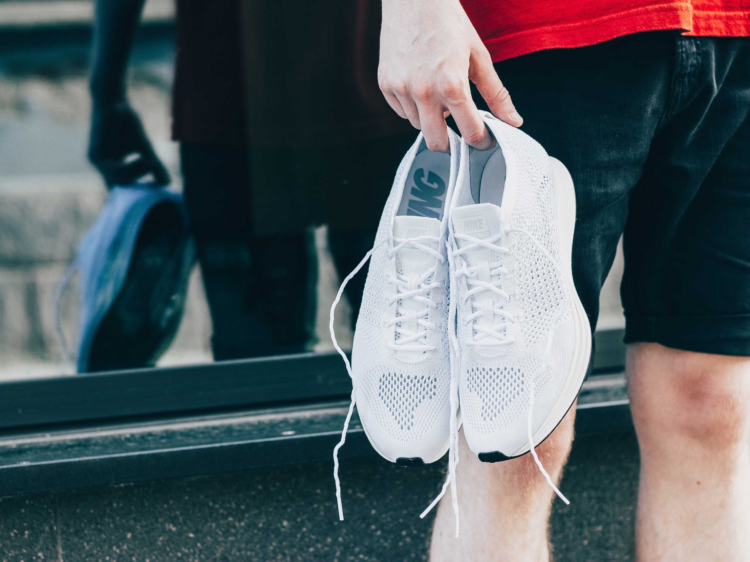 Person holding running shoes