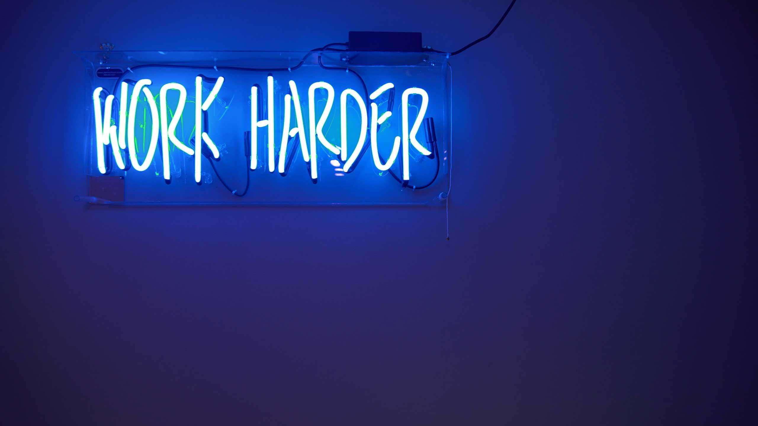 Work harder motivational sign