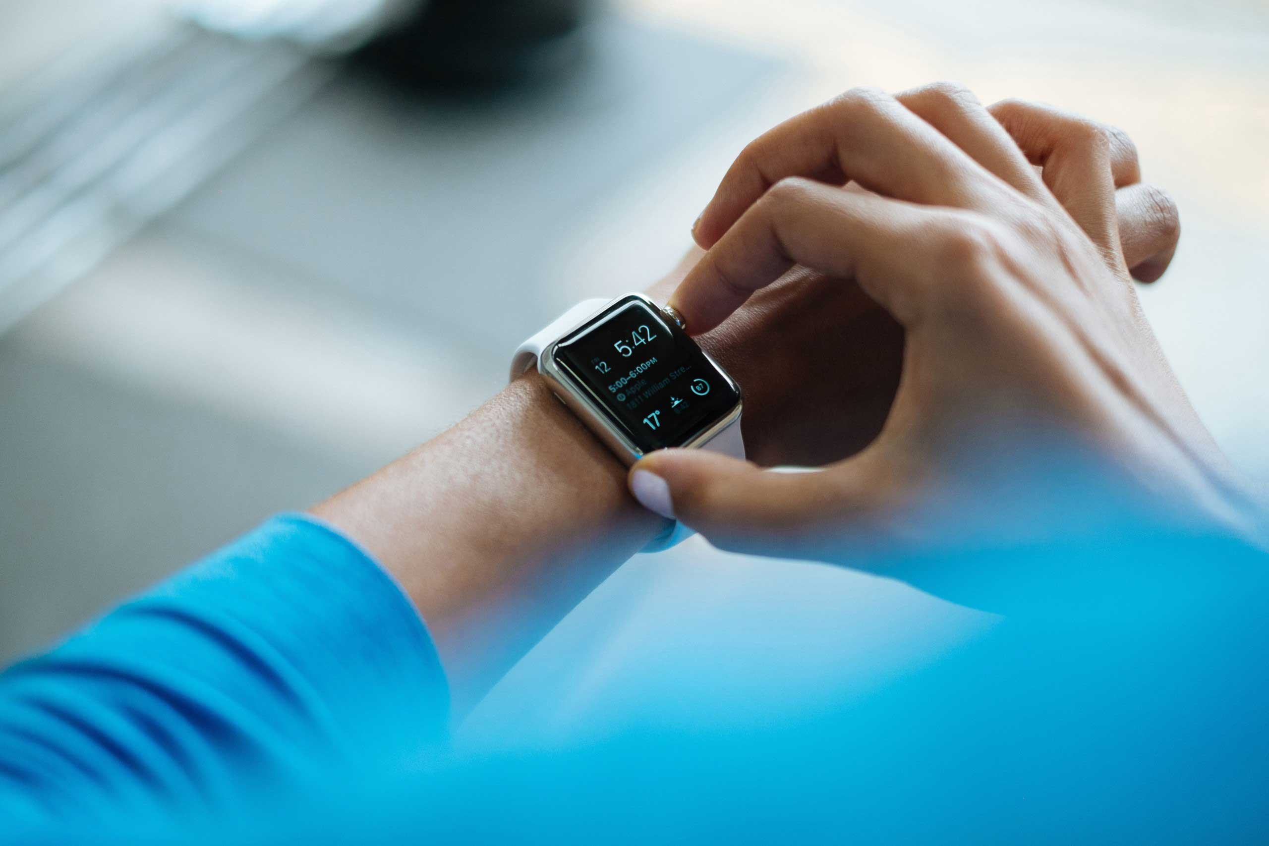 Person checking running watch