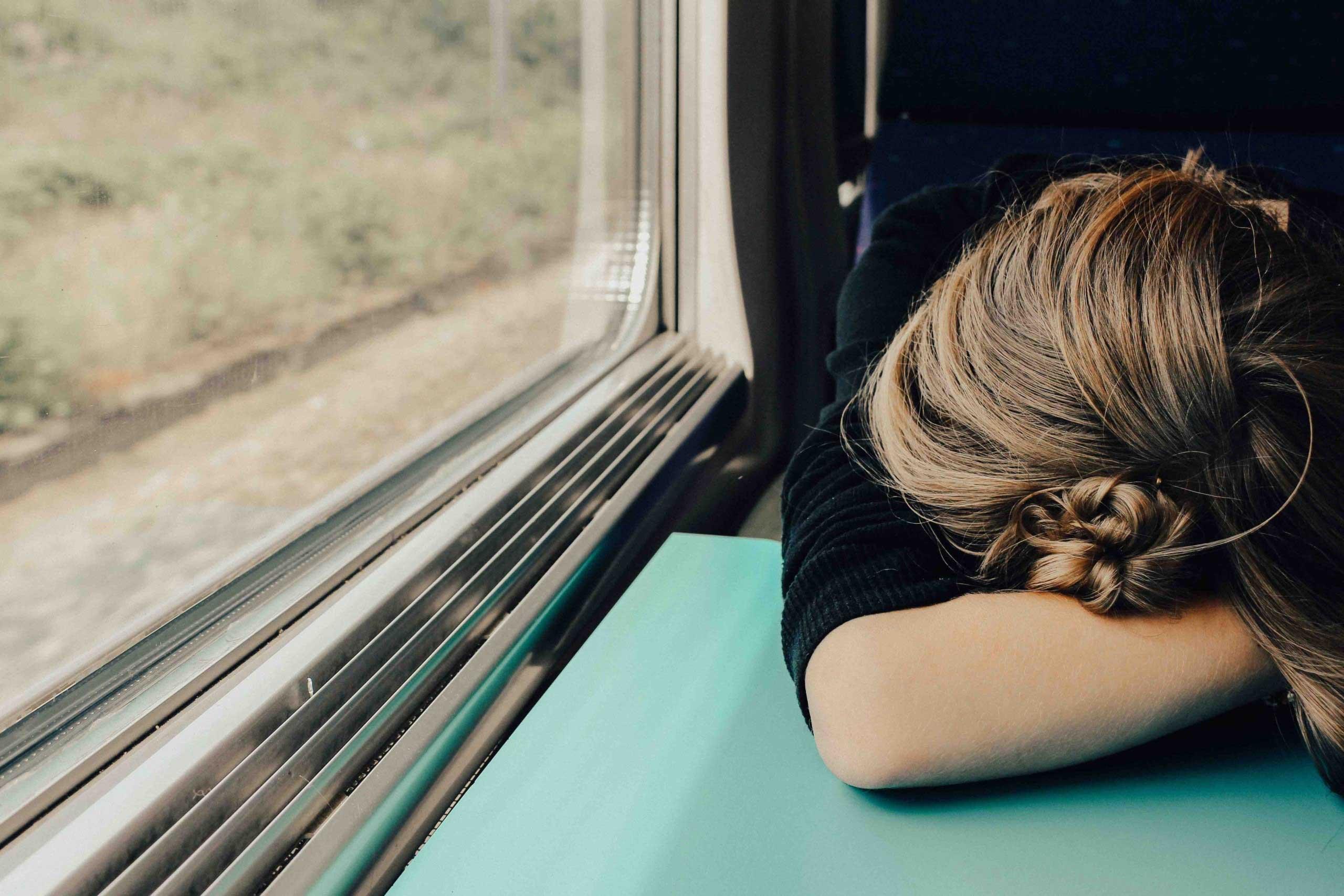 Woman sleeping on the train