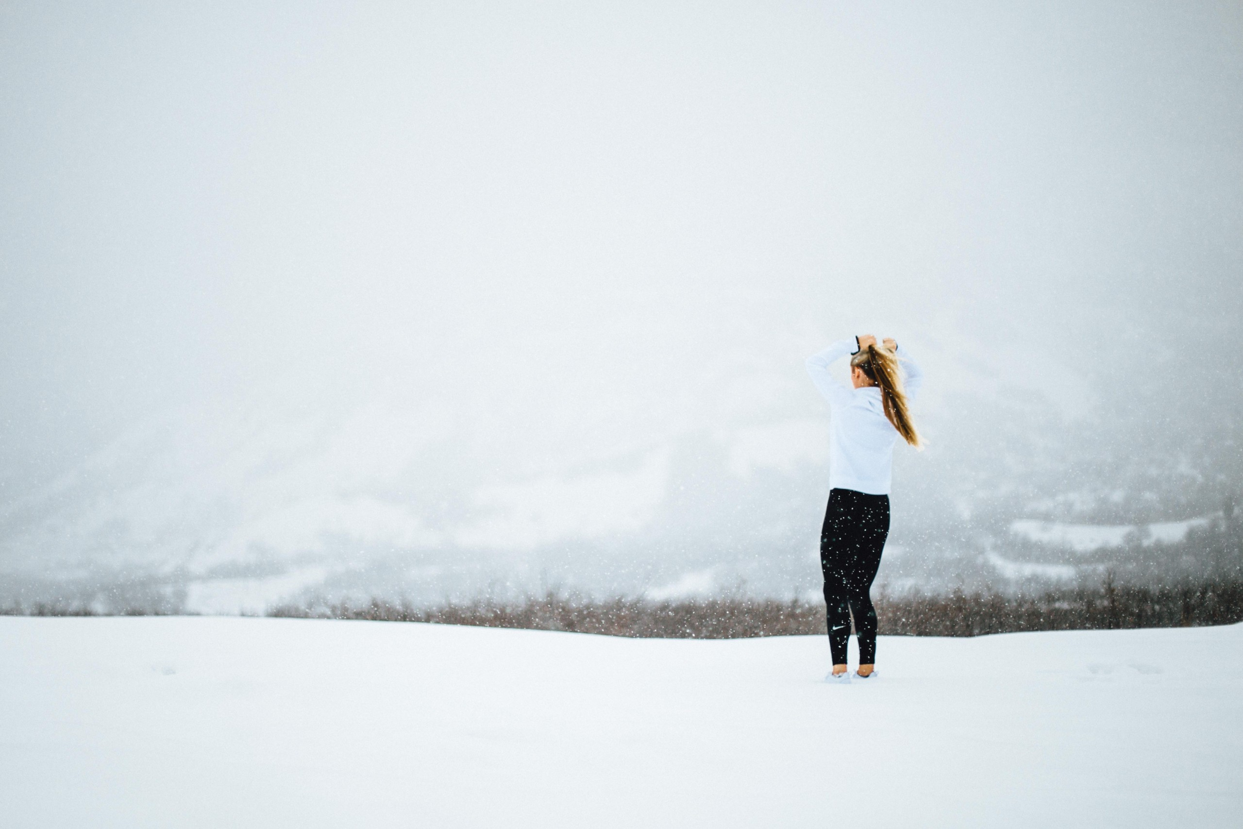 Image of a woman running during winter