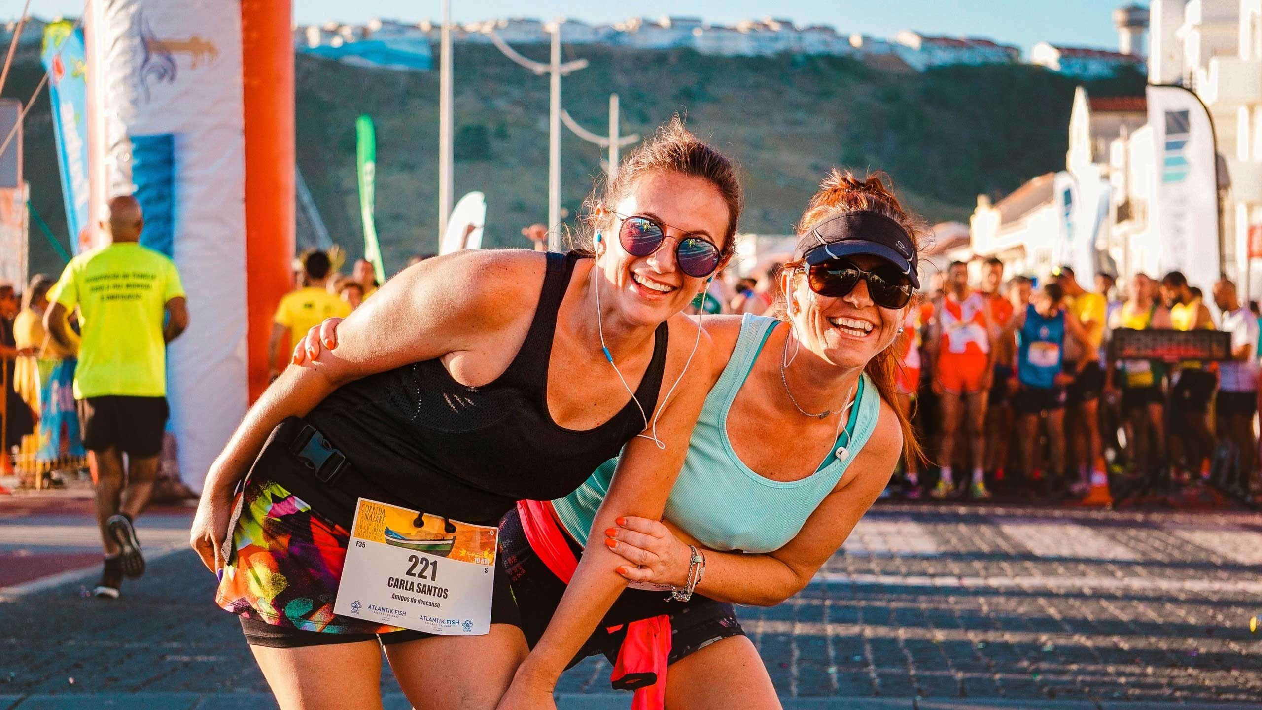 Two women at the finish line of a race