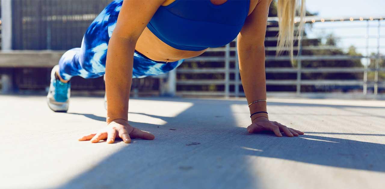 Woman doing pushups (strength training)
