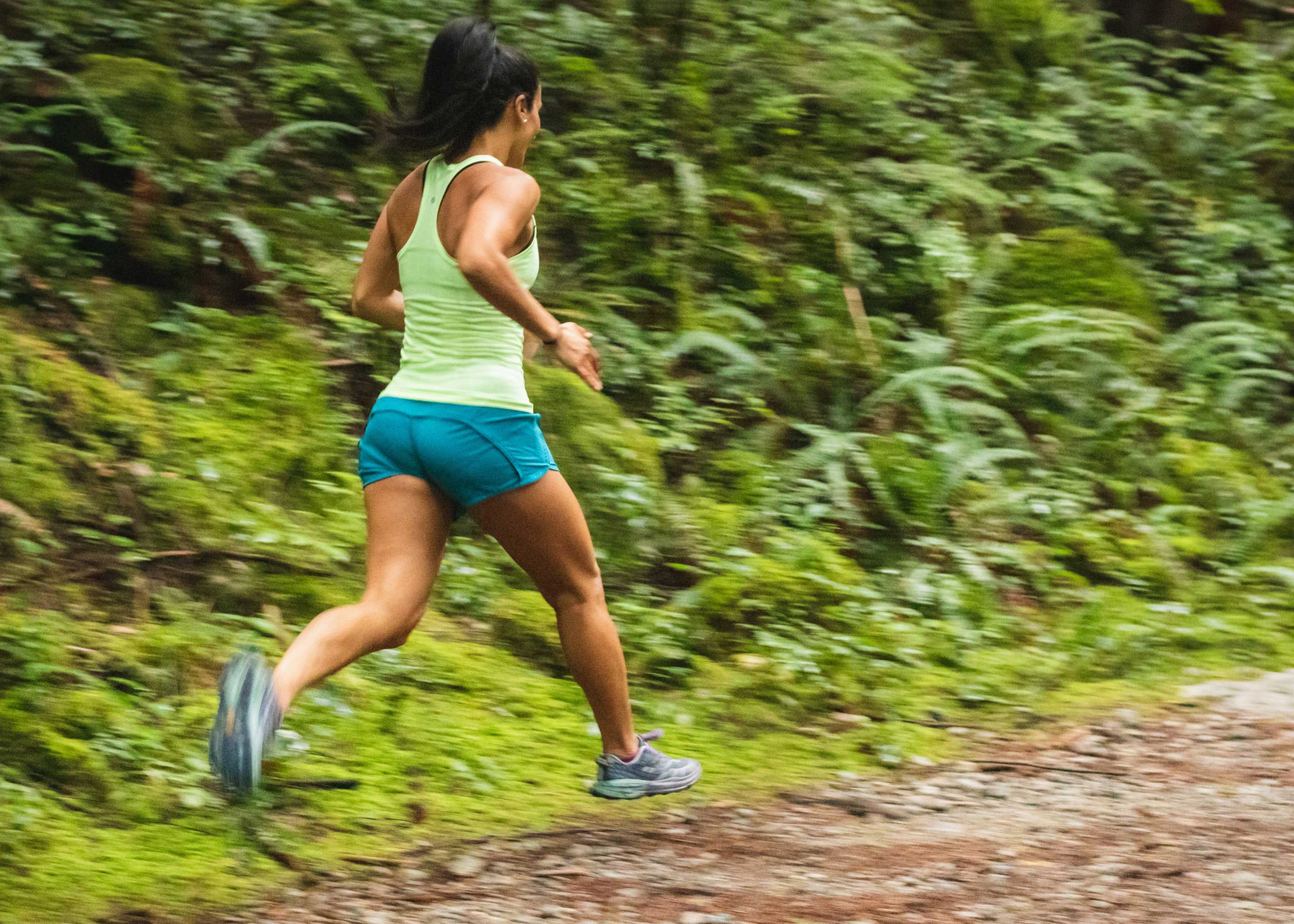 woman running on a dirth path