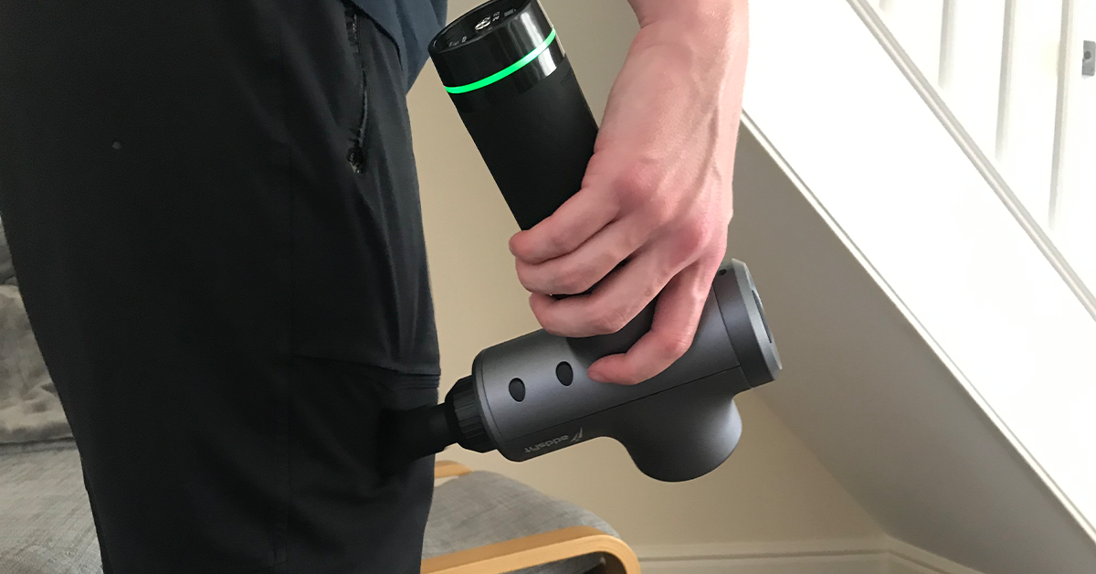 Example of a person using a massage gun