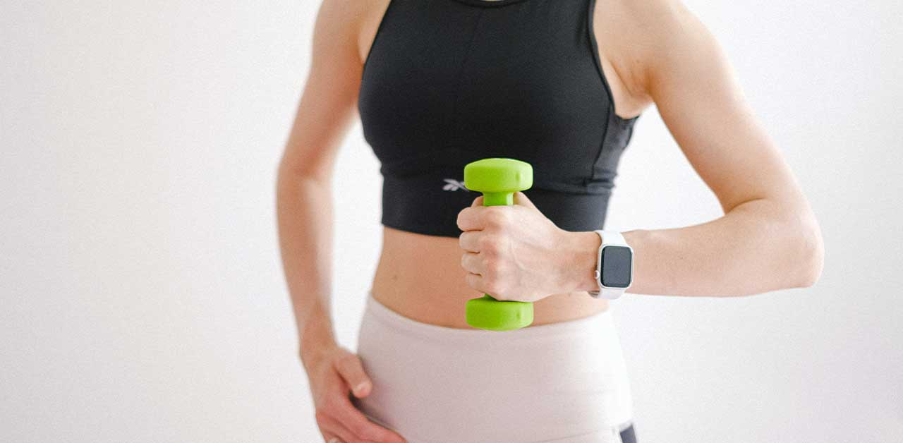Woman holding one dumbbell