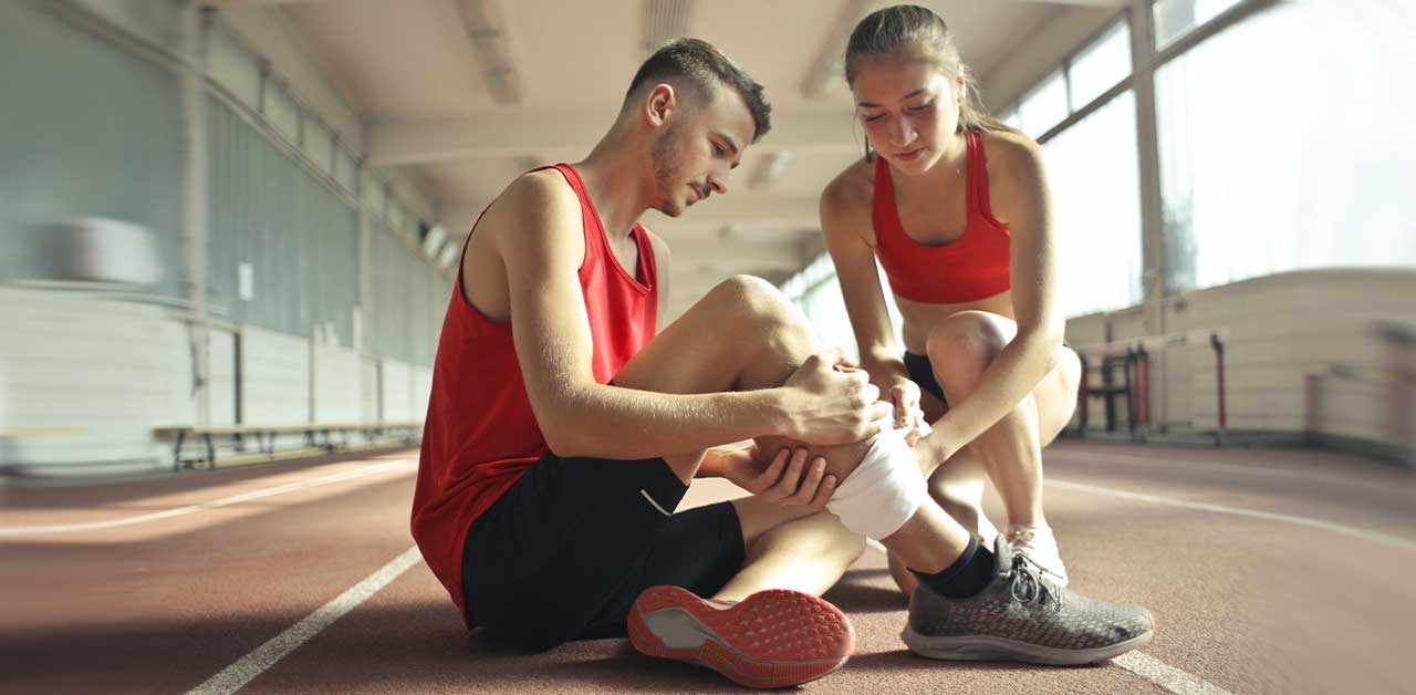 Man experiencing ankle pain after running