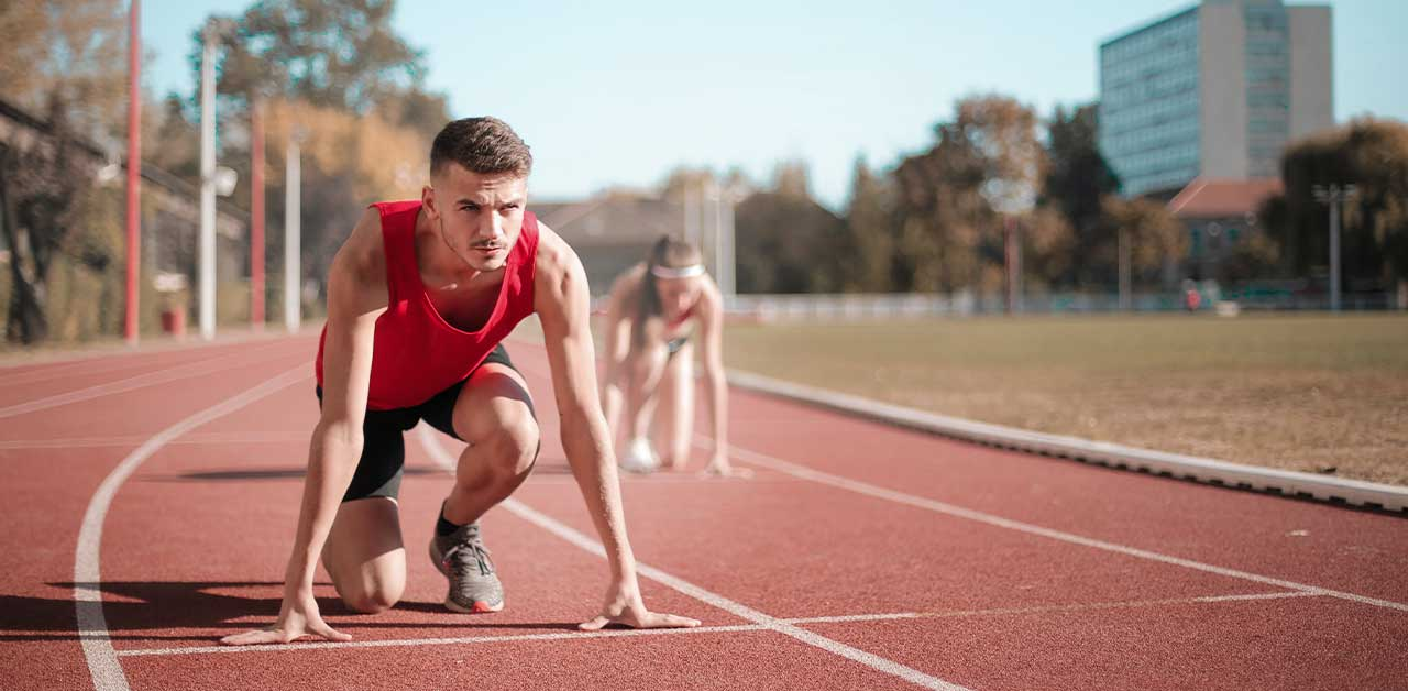 Two people running track