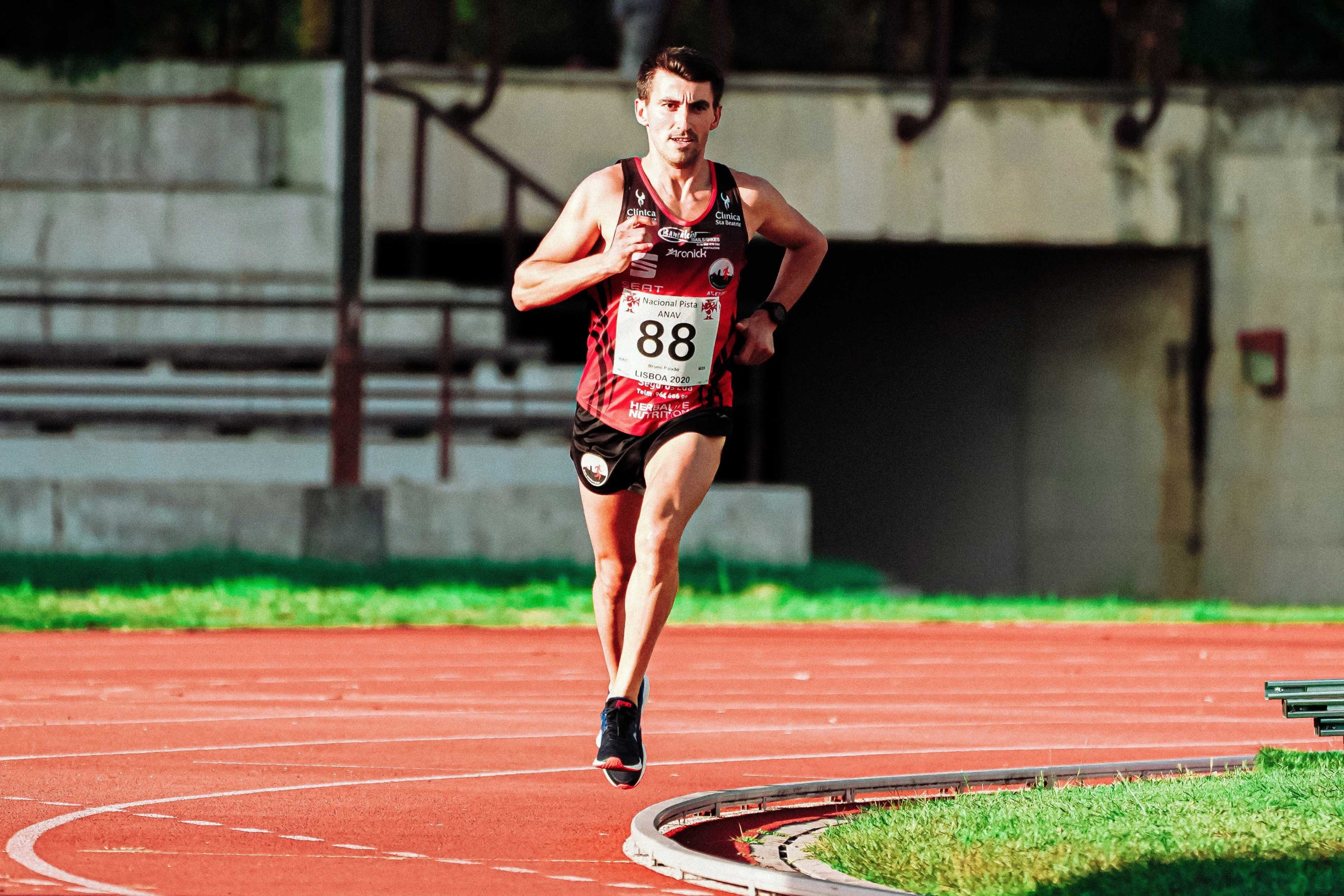Man running on an outdoor running track