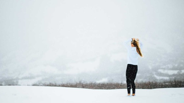 Woman running in the snow