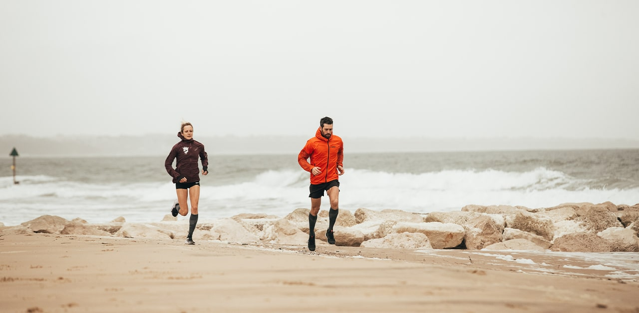 Two people running in compression running socks