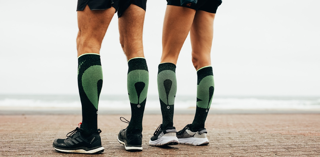 Two runners wearing the Rockay Vigor compression running socks