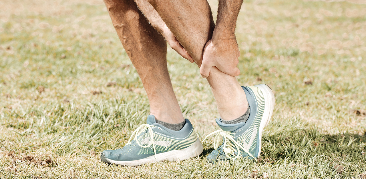 Man suffering from a running injury